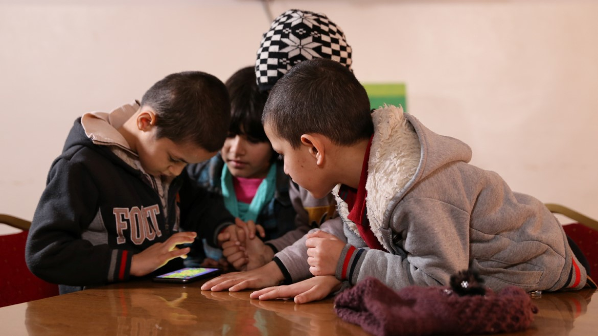 Al-Sheikh siblings play the EduApp4Syria game Antura