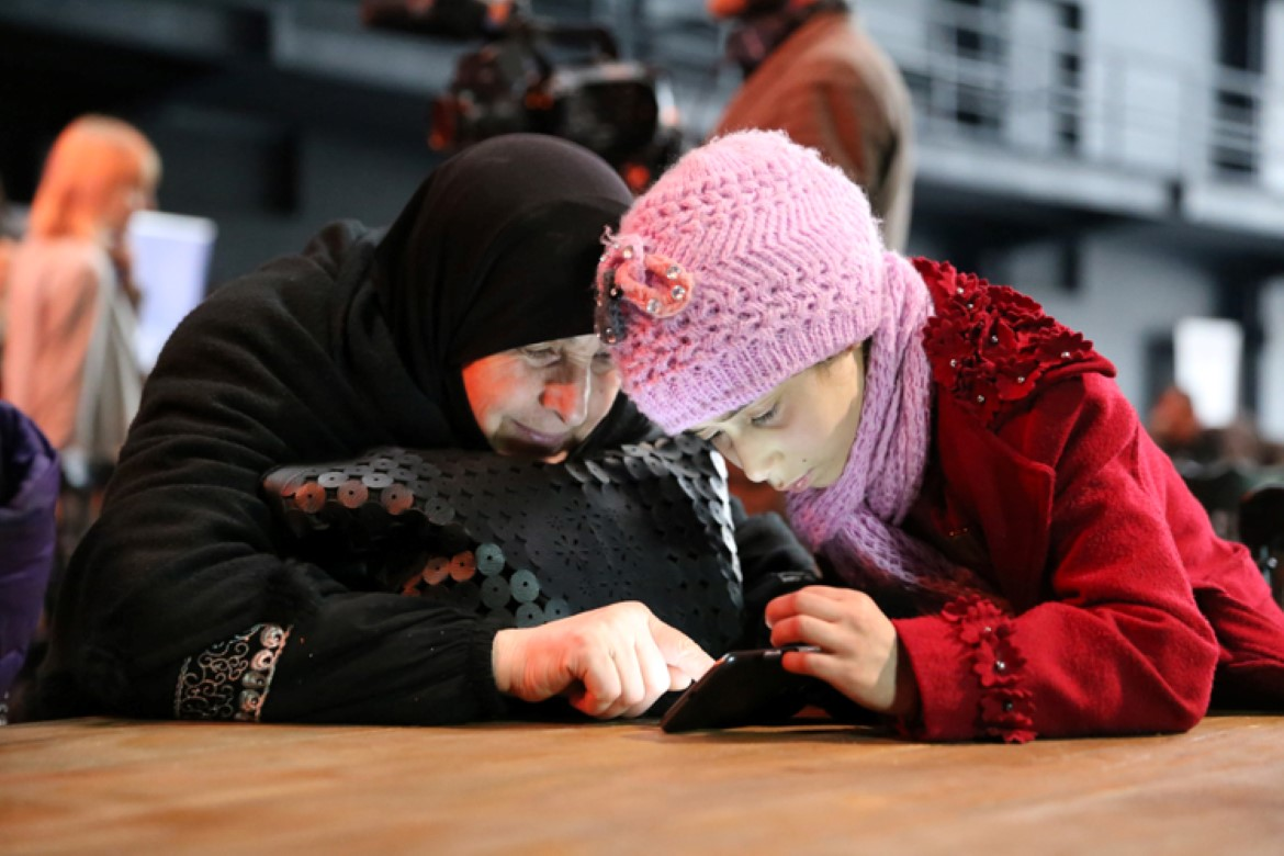 En'am Ghannam and granddaughter Amani Qarqoura test the EduApp4Syria games