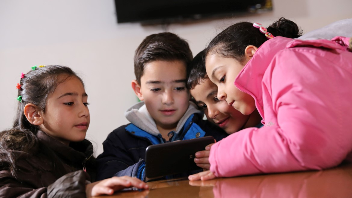 Group of Syrian children living in Jordan play the EduApp4Syria game Antura
