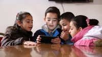 Group of Syrian children living in play the EduApp4Syria game Antura