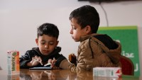 Mohammed and Khalil playing EduApp4Syria games Antura